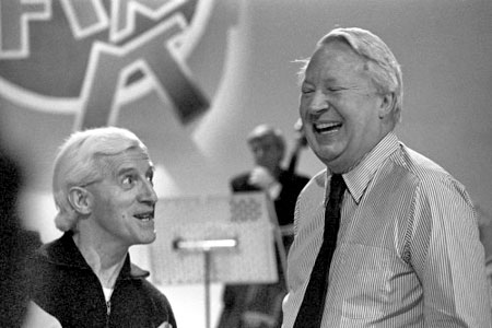 Jimmy Savile & Prime Minister Ted Heath - Beware the smiling psychopath wearing the bling of a celebrity or in the grey or blue suit of a seasoned (and thereby corrupted) politician
