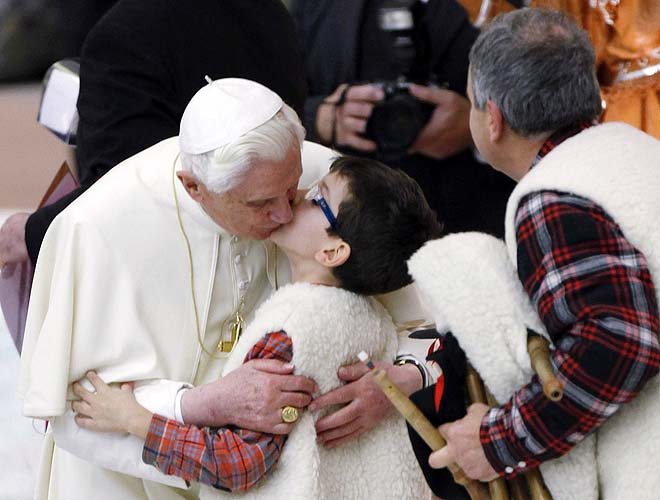 Pope Benedict XVI (Joseph Ratzinger) kisses a young bagpipe player at the end of his weekly audience at the Vatican.